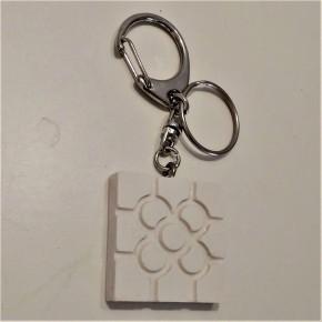 Porte-clés avec un pendentif rosette de Bilbao en résine céramique