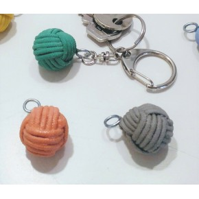 Keychain with a monkey fist pendant in ceramic resin