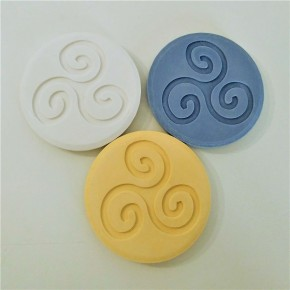 3 round coasters with trisquel
