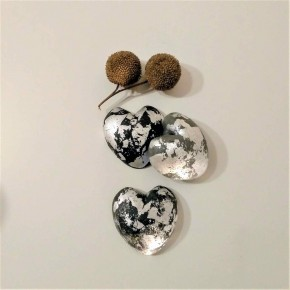 3 grey heart paperweights with silver metal finish