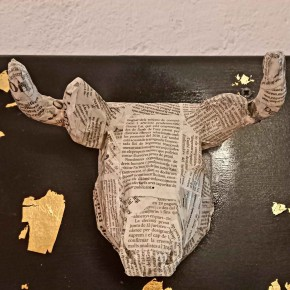 Bull decorative head with newspaper collage decoration
