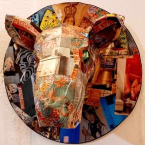 Cow decorative head with collage magazine